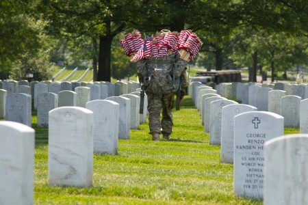 Soldiers of the 3rd U.S Infantry Regiment (The Old Guard) place flags at over 240,000-interned service members in Arlington National Cemetery during the annual Flags-In mission in Arlington National Cemetery, Va. on May 26, 2016. Every Soldier, from the regiment's Commander Col. Johnny K. Davis to the newest enlisted Solider participates in this Memorial Day tradition that honors the men and women that have served.