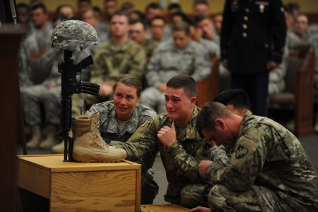 West Point cadets are overcome with emotions as they say farewell to their friend and classmate, Cadet Mitchell Winey, at the conclusion of his memorial ceremony, Jun 9, at Fort Hood, Texas. Winey was killed, along with eight Fort Hood Soldiers, when their vehicle overturned in flood waters, June 2.