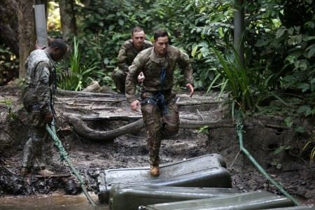 Soldiers run across an obstacle at the Jungle Warfare School near Yemen, Gabon, June 7, 2016.  Soldiers assigned to 3rd Infantry Division are attending the French Jungle Warfare School as part of Central Accord 2016, an annual, combined, joint military exercise that brings together partner nations to practice and demonstrate proficiency in conducting peacekeeping operation.