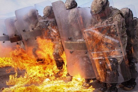 Soldiers maintain a defensive position during fire phobia training at the Joint Multinational Readiness Center in Hohenfels, Germany, Oct. 23, 2016. The Soldiers, alongside their multinational counterparts, are training in preparation for the 22nd iteration of the U.S. Army's support of Kosovo Forces as a part of Multinational Battle Group-East. They are assigned to 1st Squadron, 33rd Cavalry, 101st Airborne Division.