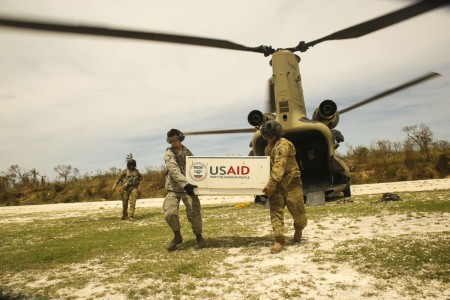 U.S. service members with Joint Task Force Matthew unload supplies from CH-47 Chinook helicopter at a landing zone in Jeremie, Haiti, Oct. 9, 2016.