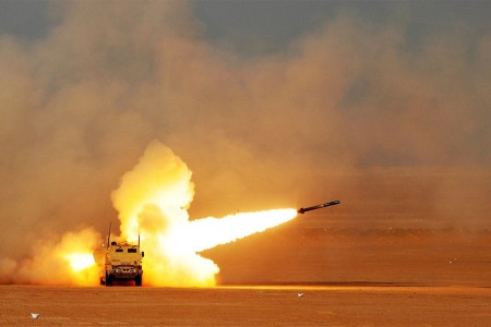 Soldiers fire a rocket from a M142 high mobility rocket system during a decisive action training environment exercise near Camp Buehring, Kuwait.  Alpha Company, 1st Battalion, 94th Field Artillery Regiment, certified four HIMARS operator crews as well as a contingent of forward observers during the exercise.