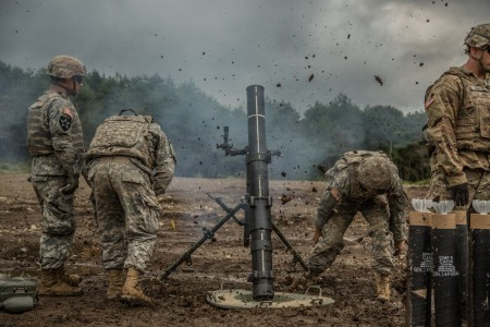 Mortar-men fire the M120 Battalion Mortar System at Albano Training Area, Japan, Sept. 13, 2016, as part of Orient Shield 2016. They are with Headquarters Company, 2nd Battalion, 27th Infantry Regiment Orient Shield is an annual bi-lateral training exercise held in Japan.