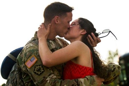 Staff Sgt. Timothy Slough, a U.S. Army Reserve military police Soldier with the 443rd Military Police Company, kisses his fiance, Alyssa Osiecki, after returning home from a 10-month deployment to Guantanamo Bay, Cuba, Sept. 9.
