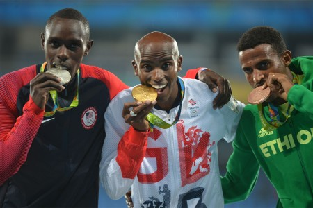 Silver medalist Spc. Paul Chelimo (left) of the U.S. Army World Class Athlete Program poses with gold medalist Mo Farah (center) of Great Britain and bronze medalist Hagos Gebrhiwet (right) of Ethiopia, Aug. 20, at Olympic Stadium in Rio de Janeiro, Brazil.
