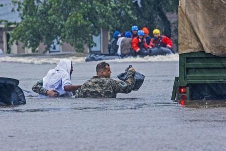 North Carolina Army National Guardsmen and local emergency services assist with evacuation efforts, Oct. 8, in Fayetteville, N.C. Heavy rains caused by Hurricane Matthew have led to flooding as high as five feet in some areas.