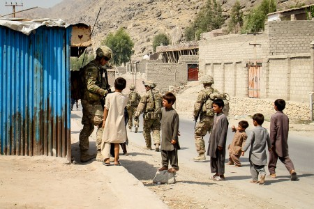 Soldiers with 3rd Cavalry Regiment, talk with local children near a village, July 29, 2016, in Laghman province, Afghanistan, while conducting a key leader engagement patrol with Afghan counterparts.