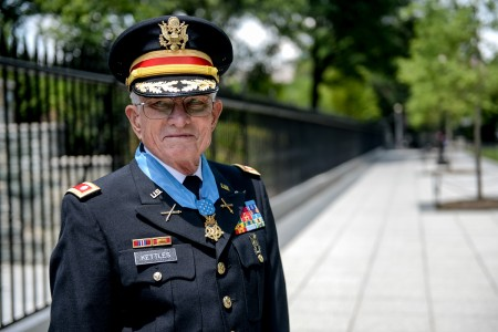 Retired U.S. Army Lt. Col. Charles Kettles is awarded the Medal of Honor at the White House in Washington, D.C., July 18, 2016, for actions during a battle near Duc Pho, South Vietnam, on May 15, 1967. Then-Maj. Kettles, assigned to 1st Brigade, 101st Airborne Division, was credited with evacuating dozens of Soldiers in a UH-1D Huey helicopter under intense enemy fire.