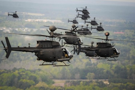 """The largest helicopter formation flight set a Guinness World Record of Thirty-two OH-58D Kiowa Warriors with the 1st Squadron, 17th Cavalry Regiment, 82nd Combat Aviation Brigade, conduct a flyover during farewell flight, Fort Bragg, N.C. The flyover serves as a final """"thank you"""" and farewell to the residents of the Fort Bragg and the Fayetteville community."""