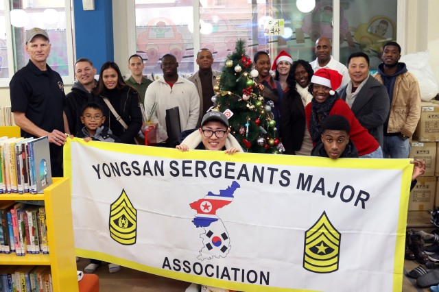 Service members of the Yongsan Sergeants Major Association pose for a group photo during their visit to Youngnak Borinwon, a Korean orphanage located in Seoul, Dec. 19. Service members of the Yongsan Sergeants Major Association visited the orphanage to hand out gifts to the children. The Yongsan Sergeants Major Association is an organization comprised of active and retired Sergeants Major that constantly looks for ways to fortify the ROK-U.S. alliance and camaraderie by giving back to the local community.