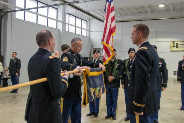 LANCASTER, Pa. - The 3rd Battalion 319th Regiment Command Sgt. Maj. David W. Hausler (left) furls the flag as the Commander of the 800th Logistics Support Brigade, Col. Bradly Boganowski, (right) awaits to receive the encased flag during the unit's deactivation ceremony held here on Dec. 17, 2016. The ceremony marks the closing of the unit as part of a larger restructuring of the 800th Logistics Support Brigade, headquartered in Mustang, Oklahoma.