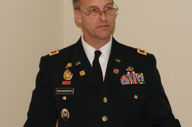 Col. Bradly Boganowski, commander of the 800th Logistics Support Brigade, speaks encouraging words to soldiers and families at the 4th Battalion, 321st Regiment's deactivation ceremony at Redstone Arsenal, Ala., Dec. 18, 2016. The 4th Battalion falls under the 800th LSB. The deactivation is part of the 800th LSB restructuring, which is a result of the overall Army Reserve drawdown.