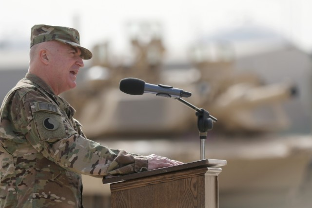 Maj. Gen. Blake C. Ortner, 29th Infantry Division commander, addresses the crowd upon assuming command of Task Force Spartan during a transfer of authority ceremony at Camp Arifjan, Kuwait Dec. 19, 2016. (U.S. Army by Sgt. Brandon Hubbard)