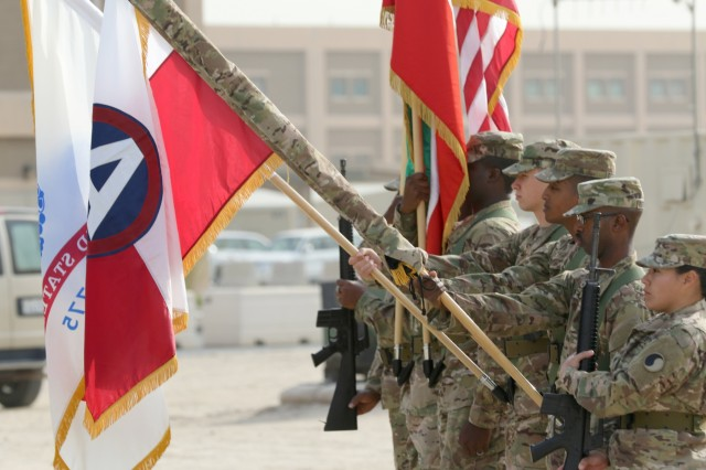 Soldiers of the 29th Infantry Division display the unit colors during a transfer of authority ceremony at Camp Arifjan, Kuwait Dec. 19, 2016. (Sgt. Brandon Hubbard)