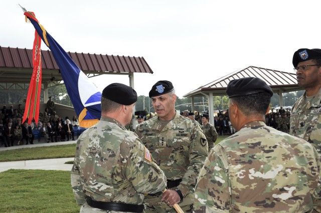 Gen. Gus Perna receives Army Materiel Command's colors from Gen. Mark A. Milley, the 39th Army Chief of Staff, while Gen. Dennis L. Via, outgoing AMC commander, and Command Sgt. Maj. James K. Sims, AMC's senior enlisted advisor, stand by. Perna assumed command of AMC during a ceremony at AMC Headquarters, Sept. 30. (Photo Credit: Doug Brewster)
