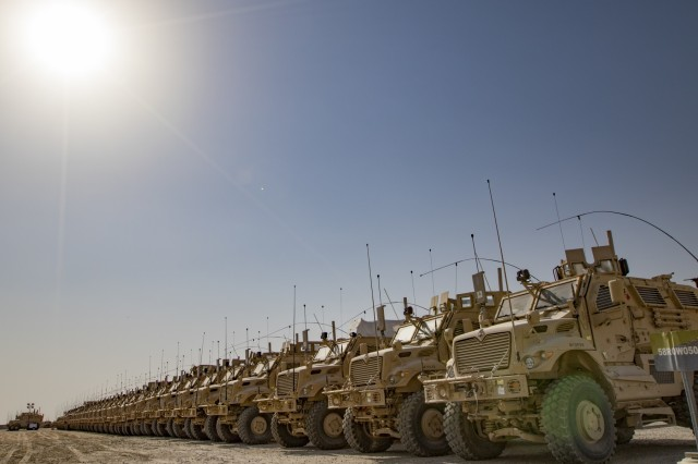 A row of Mine-Resistant Ambush Protected (MRAP) vehicles are ready and waiting in lots maintained by the 401st Army Field Support Brigade, Oct. 22, 2016, at Camp Arifjan, Kuwait. The 401st AFSB is a forward presence of the U.S. Army Sustainment Command (ASC) that provides equipment and material for troops all over U.S. Central Command's area of operations. (U.S. Army photo by Sgt. Angela Lorden)
