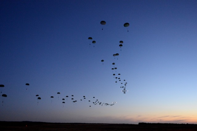 Soldiers from the 1st Battalion, 508th Parachute Infantry Regiment, conduct a static line airdrop from an Air Force C-17 Globemaster III aircraft during Joint Operational Access Exercise 13-02 at Sicily drop zone, Fort Bragg, N.C., Feb. 24, 2013. The JOAX exercises are combined exercises that enable U.S. and Canadian mobility aircrews to train with paratroopers from the Army's 82nd Airborne Division on projecting combat power in a denied environment -- one of the future-war challenges areas that spurred the department to launch the recent Operational Challenges Crowdsourcing Initiative.