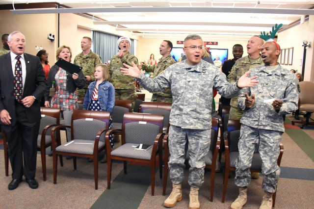 "U.S. Army Space and Missile Defense Command/Army Forces Strategic Command employees participate in singing ""The Twelve Days of Christmas"" during the command's Redstone Arsenal, Alabama, headquarters' 2016 Holiday Party program Dec. 15."