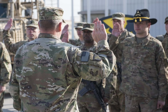 Army Chief of Staff Gen. Mark Milley gives the oath of enlistment to deployed Soldiers during a re-enlistment ceremony Dec. 18, 2016, on Bagram Airfield, Afghanistan.