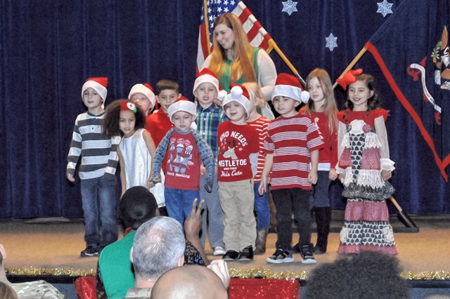Children from the CDC Strong Beginnings Pre-K perform holiday songs for parents and community leaders at the St. Nick's Benefit Ceremony Dec. 13 at Grand Hall Auditorium near Fort Leonard Wood, Missouri.