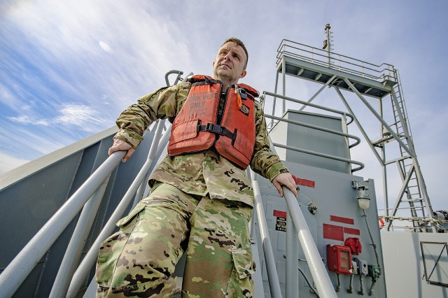 Staff Sgt. Benjamin McGalliard, watercraft maintenance NCOIC, 401st Army Field Support Battalion-Kuwait, descends stairs to the load deck after checking the anchor mechanism on an upper-deck aboard the Army Landing Craft Utility 2016 Corinth during a sea trial at Kuwait Naval Base, Kuwait, Dec. 21. (U.S. Army Photo by Justin Graff, 401st AFSB Public Affairs)