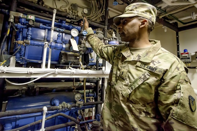 Chief Warrant Officer 3 Wendell McNeil, watercraft maintenance chief, 401st Army Field Support Battalion-Kuwait, inspects engine room components aboard the Army Landing Craft Utility 2016 Corinth during a sea trial at Kuwait Naval Base, Kuwait, Dec. 21. (U.S. Army Photo by Justin Graff, 401st AFSB Public Affairs)