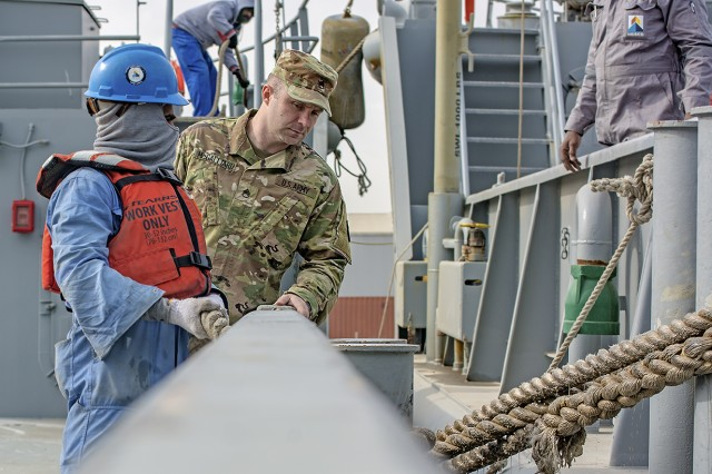 Staff Sgt. Benjamin McGalliard, watercraft maintenance NCOIC, 401st Army Field Support Battalion-Kuwait, observes crew members tying the Army Landing Craft Utility 2016 Corinth into port during a sea trial at Kuwait Naval Base, Kuwait, Dec. 21. (U.S. Army Photo by Justin Graff, 401st AFSB Public Affairs)