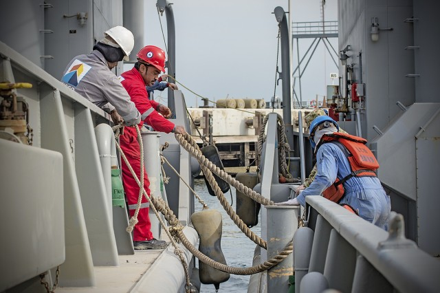 Crew members tie the Army Landing Craft Utility 2016 Corinth into port during a sea trial at Kuwait Naval Base, Kuwait, Dec. 21. (U.S. Army Photo by Justin Graff, 401st AFSB Public Affairs)