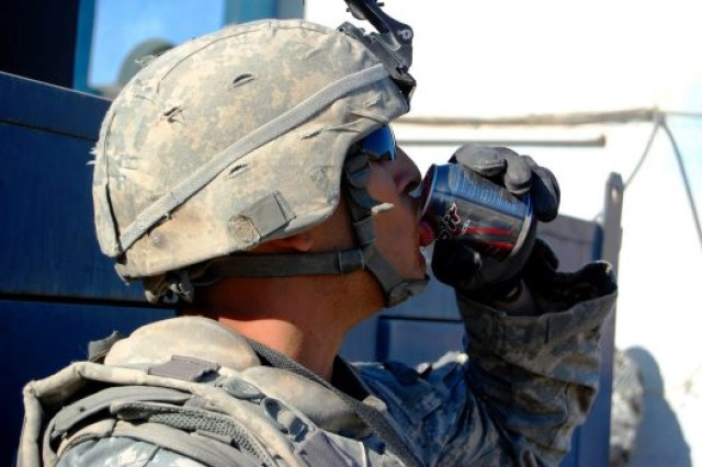 Spc. Kyle Lauth, assigned to Alpha Company, 1st Battalion, 27th Infantry Regiment, sips an energy drink before a dismounted patrol through the Hussainiyah town of the Istaqlal Qada district northeast of Baghdad, Dec. 29, 2008.