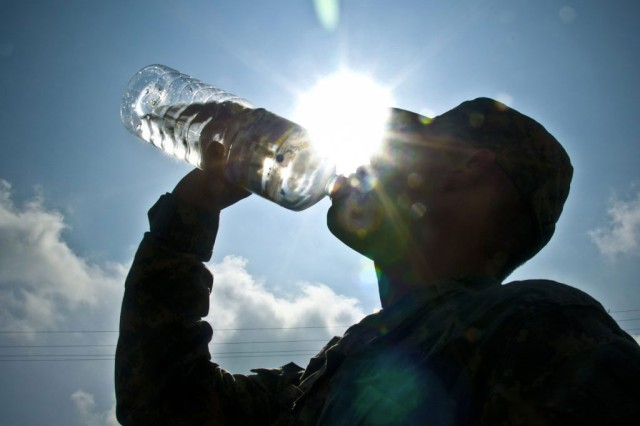 Dehydration is caused by not drinking enough water. The amount of water necessary to keep someone hydrated depends greatly on the weather, the amount of physical activity, and an individual's physical fitness level. The symptoms of dehydration include lethargy, headaches and lack of energy.