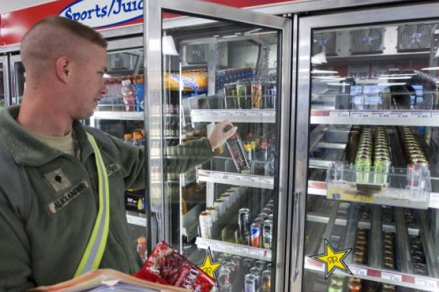 Spc. Kevin Alexander of 138th Quartermaster Company grabs an energy drink at the Camp Atterbury Post Exchange. Most energy drinks contain anywhere from 70 to 200 milligrams of caffeine. The daily recommended intake of caffeine is no more than 300 milligrams.