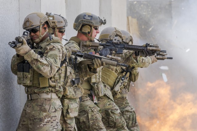 U.S. Special Forces Green Beret Soldiers assigned to 7th Special Forces Group (Airborne) prepare to breach an entry point during Integrated Training Exercise 2-16 at Marine Corps Air Ground Combat Center, Twentynine Palms, California, in February 2016. Acquisition leaders are taking steps—improved agility, better long-range planning processes and redesigned oversight guidelines—that will help U.S. warfighters continue to maintain dominance. (U.S. Air Force photo by Tech Sgt. Efren Lopez)