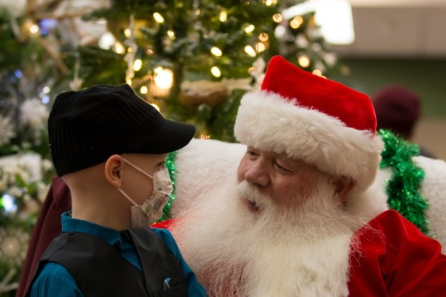 Garen Moore, 6, sits on Santa's lap after helping to light the Christmas Tree on Dec. 2 in the Medical Mall of Madigan Army Medical Center, Joint Base Lewis-McChord, Wash.