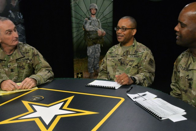 Command Sgt. Maj. Wardell Jefferson of U.S. Army Human Resources Command (right), with Command Sgt. Maj. David Davenport of U.S. Army Training and Doctrine Command (left) and Sgt. Maj. Derek Johnson, deputy chief of staff G1 sergeant major at Headquarters Department of the Army, take on talent management during the third town hall in November at Fort Eustis, Virginia.