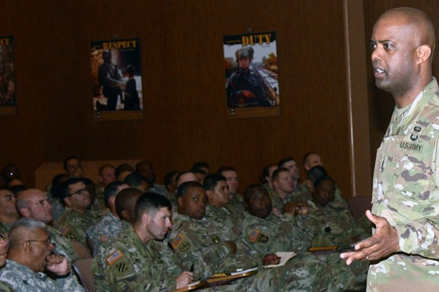 U.S. Army Human Resources Command Sgt. Maj. Wardell Jefferson (right), with Maj. Gen. Thomas Seamands, HRC commander, discusses professional development with noncommissioned officers Dec. 14 at Fort Bliss, Texas. Jefferson says road shows are part of HRC's efforts to show transparency.