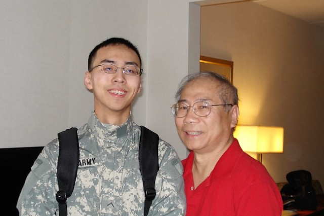Ming Koh, a pharmacy technician at Madigan Army Medical Center at Joint Base Lewis-McChord, Washington, stands beside his son Doug, an Army ROTC cadet.