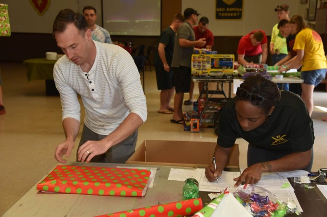 "The 27th Infantry Regiment's ""Wolfhounds"" Soldiers and family members held a gift-wrapping event Dec. 3, 2016, for the children of the Holy Family Home orphanage in Osaka, Japan."