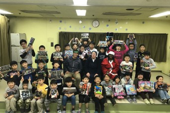 """""""Wolfhound Santa"""" Travels to Osaka, Japan to deliver Gifts to the Children of Holy Family Home"""
