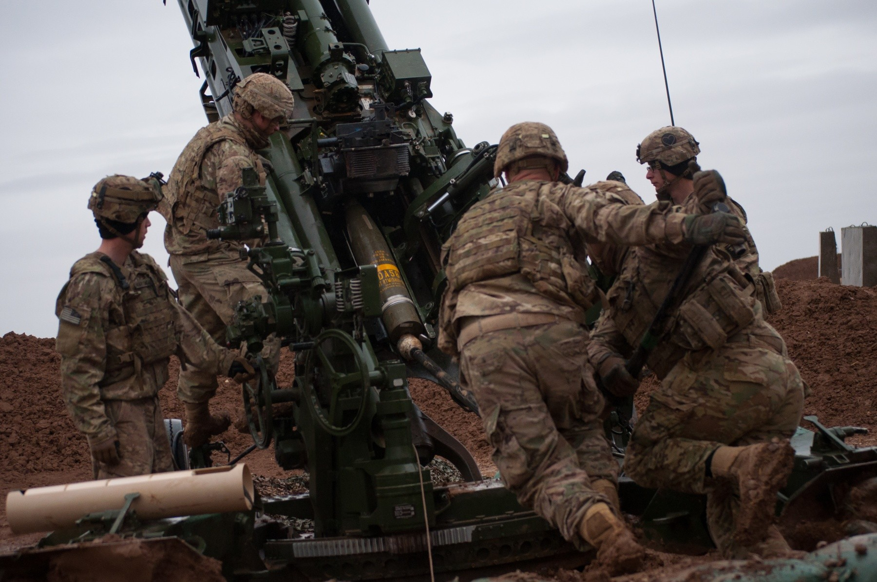 U.S Army Soldiers with Battery C, 1st Battalion, 320th Field Artillery Regiment, Task Force Strike, load a round into M777 artillery piece to support the Iraqi security forces during the Mosul counter offensive, Dec. 24, 2016, in northern Iraq. Battery C is supporting the ISF with indirect fires in their fight against ISIL. (Photo Credit: 1st Lt. Daniel Johnson)