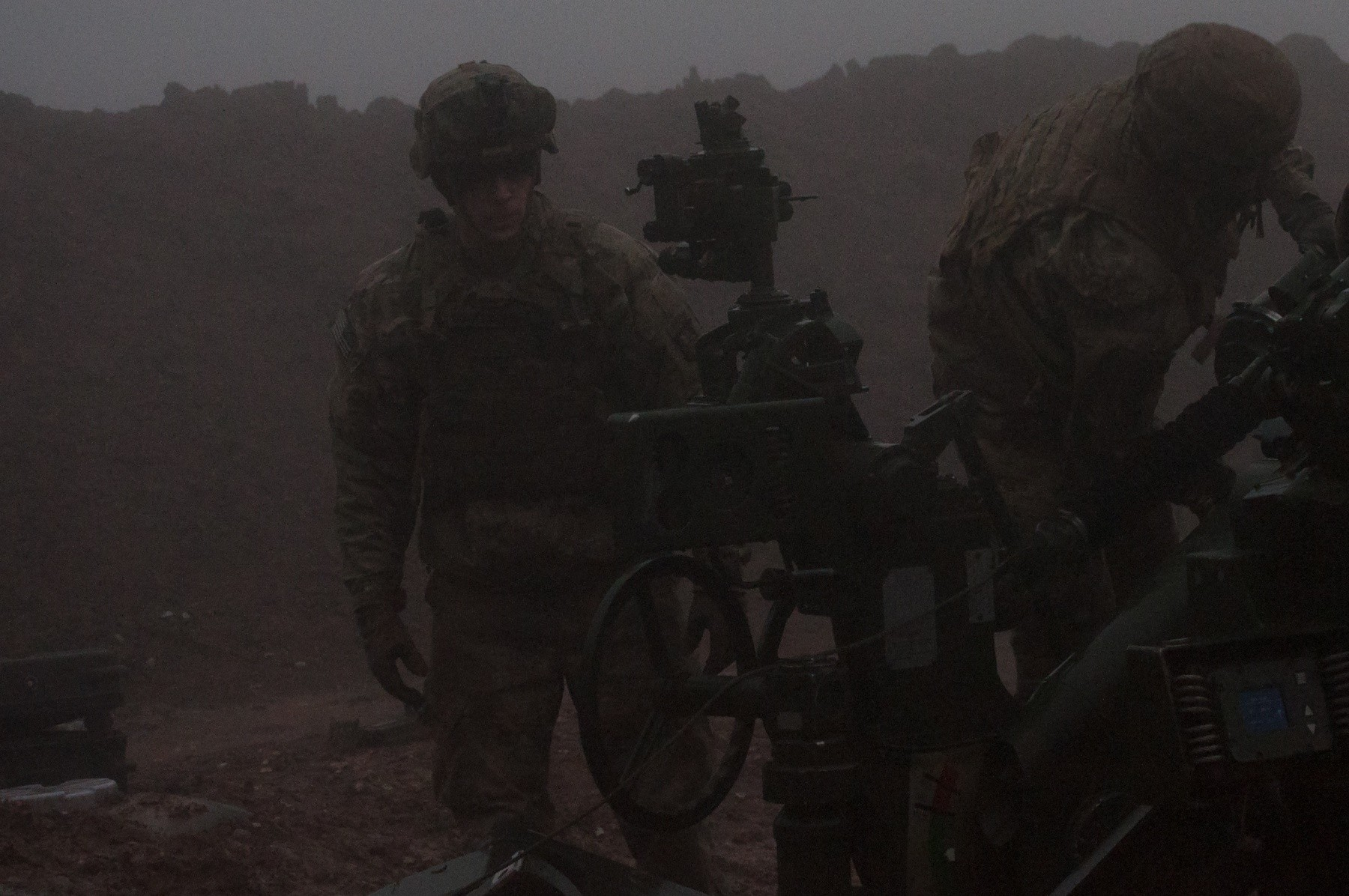U.S. Army Sgt. Scott Martineau, Battery C, 1st Battalion, 320th Field Artillery Regiment, Task Force Strike, moves towards his position on an M777 howitzer during a fire mission to support the security forces during the Mosul counteroffensive, Dec. 25, 2016, in northern Iraq. Battery C is supporting the ISF with indirect fires in their fight against ISIL. (Photo Credit: 1st Lt. Daniel Johnson)