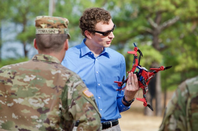John Gerdes, an engineer with the U.S. Army Research Laboratory, explains the capabilities of the On-Demand Small Unmanned Aircraft System, or ODSUAS, to Soldiers at the Army Expeditionary Warrior Experiments, or AEWE, at Fort Benning, Georgia, Dec. 1, 2016.
