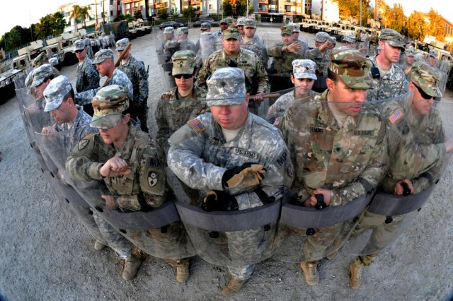 Members of the 270th and 649th Military Police Companies, 49th Military Police Brigade, California Army National Guard, move into formation to respond to a civil disturbance in Los Angeles, Nov. 17, 2016, during Exercise Vigilant Guard 17 at the Federal Emergency Management Agency Headquarters, California Task Force I, Los Angeles.