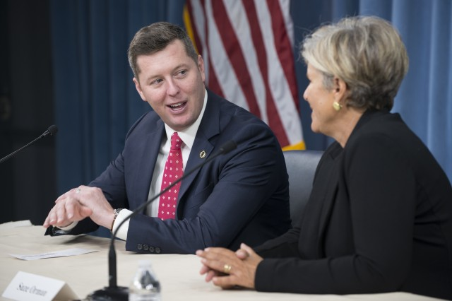 Under Secretary of the Army Patrick Murphy, left, talks about the Army's new partnership with Suze Orman, a personal finance expert, during a news conference at the Pentagon in Washington, D.C., Jan. 4, 2017.
