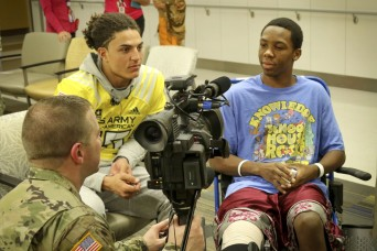 All-American athletes, Soldiers join forces to bring smiles to sick kids