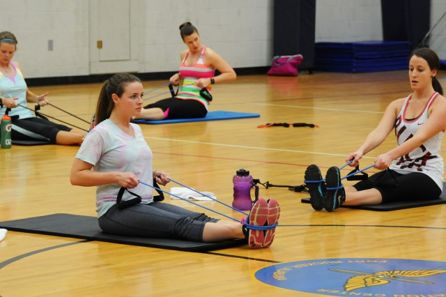 Participants of the 2015 Resolution Execution use resistance bands during their Strong Bodies workout at Fortenberry-Colton Physical Fitness Center.