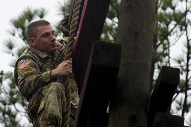 "Pvt. Adam Klover, a rigger assigned to the 151st Division Aerial Delivery Company, 189th Combat Sustainment Support Battalion ""Superchargers,"" reaches the top of the tough one obstacle as he begins the air assault school obstacle course on Fort Bragg, N.C., January 4, 2017.  Air Assault teaches Paratroopers and Soldiers how to use rotary wing assets to accomplish the mission.  (U.S. Army photo by Sgt. Daniel Schroeder, 82nd Airborne Division Sustainment Brigade, Released)"