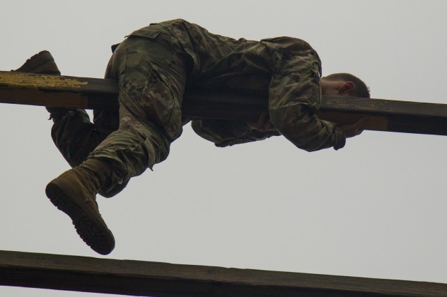 "Pvt. Jon-Luk Cole, a rigger assigned to the 151st Division Aerial Delivery Company, 189th Combat Sustainment Support Battalion ""Superchargers,"" makes his way to the top of the last obstacle, the confidence tower, as he tackles the air assault school obstacle course on Fort Bragg, N.C., January 4, 2017.  Air Assault teaches Paratroopers and Soldiers how to use rotary wing assets to accomplish the mission.  (U.S. Army photo by Sgt. Daniel Schroeder, 82nd Airborne Division Sustainment Brigade, Released)"