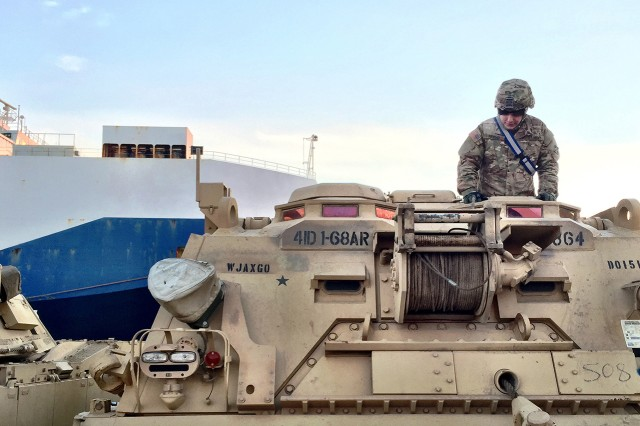 BREMERHAVEN, Germany -- Pfc. Traven Friend, a tank mechanic with Forward Support Detachment, 4th Squadron, 10th Cavalry Regiment, 3rd Armored Brigade Combat Team, 4th Infantry Division, conducts maintenance on an M88 recovery vehicle during seaport operations to offload the brigade's heavy equipment from a cargo vessel at the port of Bremerhaven, Germany, January 6, 2017. The 3rd ABCT's Soldiers and equipment began arriving in Germany this week to kick off the beginning of the heel-to-toe rotations of U.S.-based armored brigades to Europe in support of Operation Atlantic Resolve. (U.S. Army photo by Capt. Scott Walters, 3rd Armored Brigade Combat Team, 4th Infantry Division)