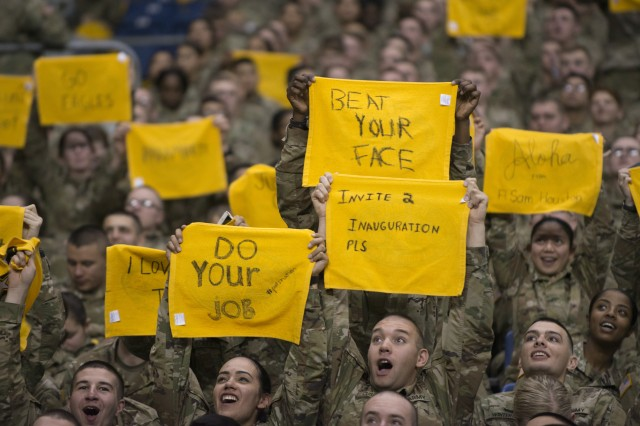 Fort Sam Houston trainees try their best to get on the jumbo screen during the Army All-American Bowl in San Antonio Jan. 7, 2017.