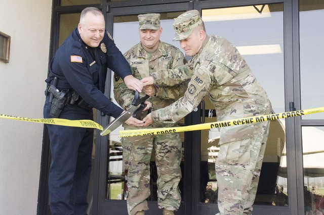 "Fort Campbell Garrison Commander Col. James ""Rob"" Salome helped cut the ribbon during the opening ceremony of the new Provost Marshal and Military Police station Aug. 8."